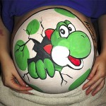 A Hatching Yoshi Painted on a Pregnant Belly [pic]